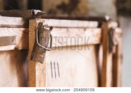 Old vintage shipping box made of wood for bulky cargo and use on old post
