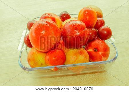 Beautiful sweet peaches nectarine and plums. Ripe fruit on the table - Retro color