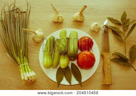 Green Cucumber. Include fresh organic vegetables on wooden floor. Fresh raw vegetables on the table - Retro color