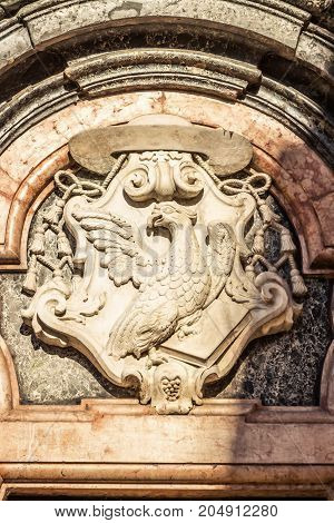 Marble emblem with bird on the church Chiesa di San Giovanni Evangelista in Parma Emilia-Romagna Italy.