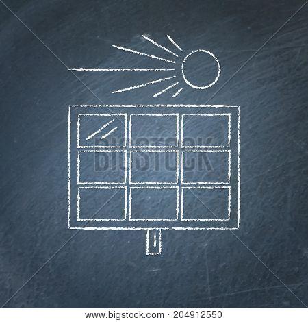 Solar panel sketch on chalkboard. Alternative renewable energy source symbol - chalk drawing on blackboard.