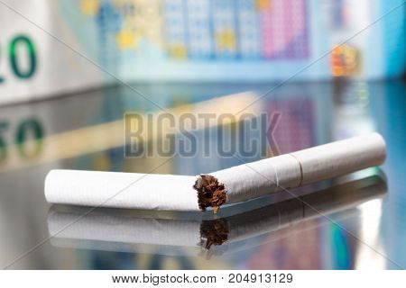 Quit smoking and save money, broken cigar