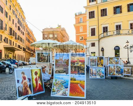 ROME, ITALY - SEPTEMBER 1, 2013: Pictures of street artists on streets of Rome