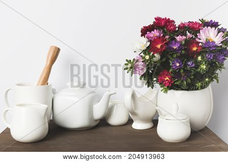 Kitchen Utensils And Flowers