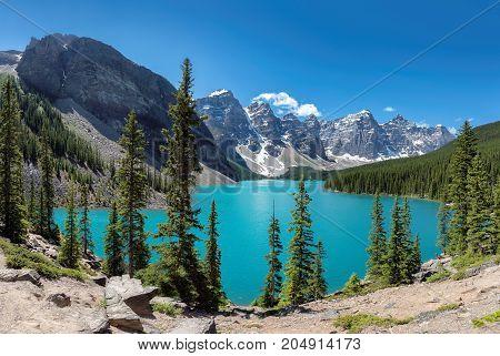 Panorama of Moraine Lake with beautiful turquoise waters, Banff National Park, Canadian Rockies, Alberta, Canada.