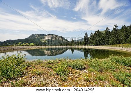 The Einstein mountain in Tyrol Austria with storage pond poster