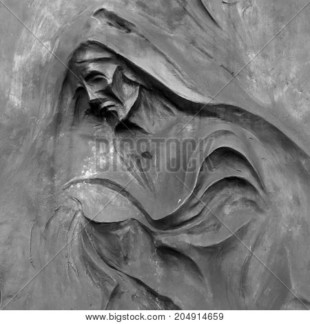 Stone sculpture of Grim the Reaper (Death Taker or Angel of the Death). Halloween concept and more.