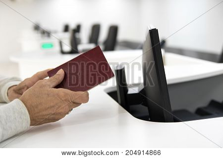 Older woman wait passport check in the airport