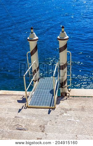 Small pier for boats. Water pier. Nature