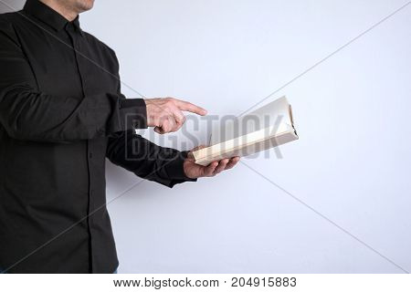 Free space for text, marketing education and business information. Man with a book on white background.