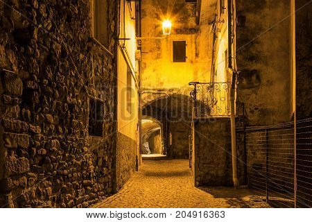 Ancient Street With Arch In The Night