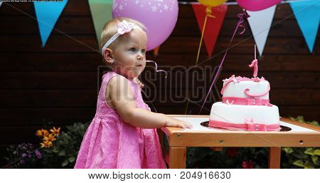 Portrait of cute little girl at birthday party