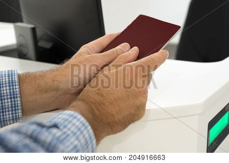 Man wait passport check and boarding card in airport