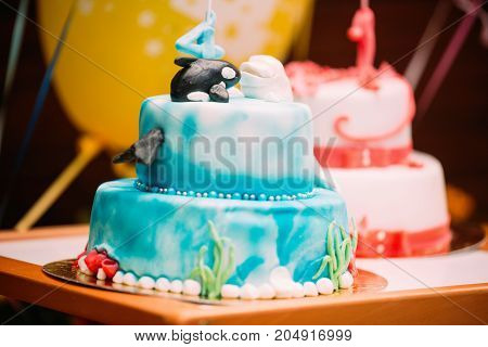 Picture of two sweet birthday cakes and ballon in background