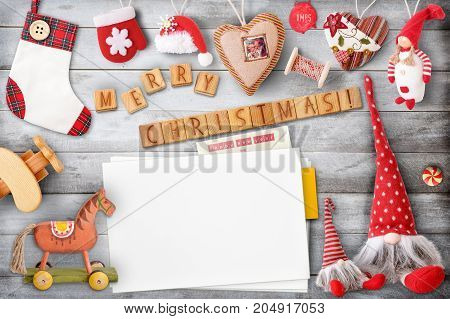 Christmas Greeting Card with Xmas Elements and Toys on Gray Wooden Background. Retro Style. Space for Text.