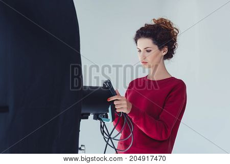 Female Photographer With Softbox