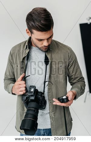 Photographer With Camera And Light Meter