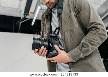 Photographer With Digital Camera And Lens