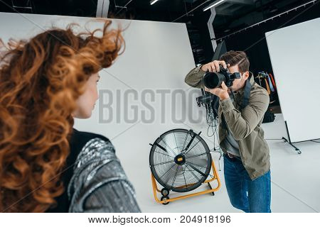 Professional Photographer And Beautiful Model