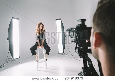 Photographer And Model In Studio