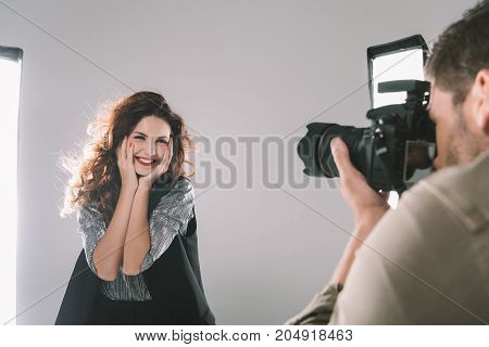 Photographer Taking Photos With Model