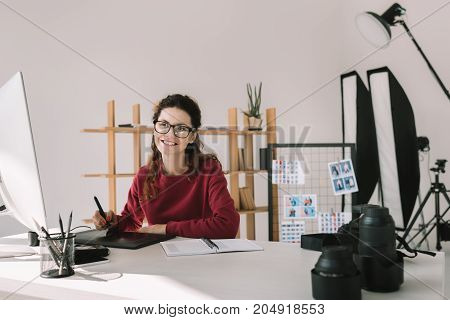 Photographer Working In Modern Office