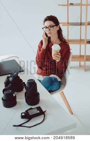 Female Photographer With Smartphone
