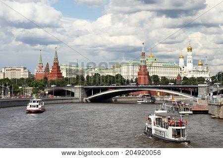 Pleasure Boats Sails Along The River Near The Moscow Kremlin.