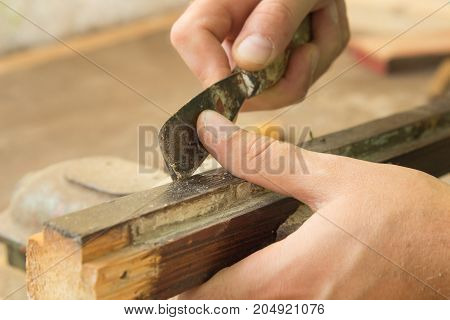 Carpenter working in his small