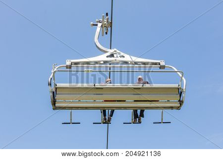 Ski Lift Chair In The Alps - Unrecognisable People In It