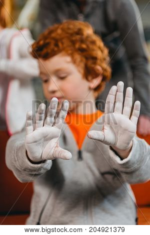 Boy Showing Hands Covered In Talcum