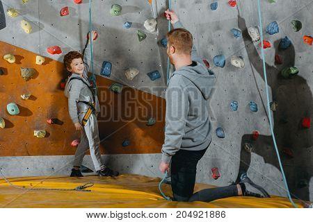 Little Boy In Climbing Harness