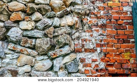 Stone old wall from huge blocks. Background of stones. Beautiful textured vintage antique background. Old masonry and a new brick with stone.