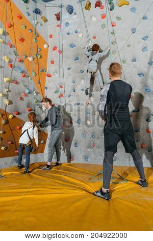 Family Training Climbing Walls With Grips