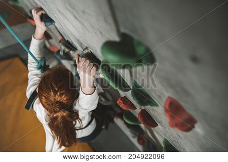 Girl Climbing Wall With Grips