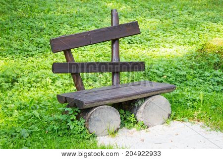 Empty Old Wooden Bench On A Green Lawn. Garden Or Park, Outdoors