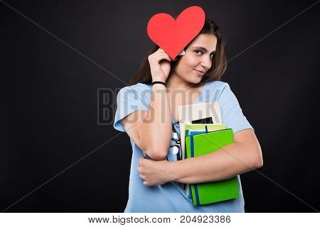 Pretty Young College Girl Holding Red Paper Heart