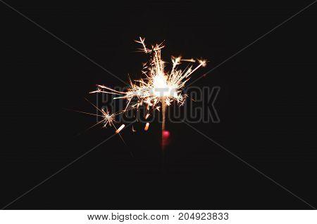 Sparkler firework light glowing in the dark