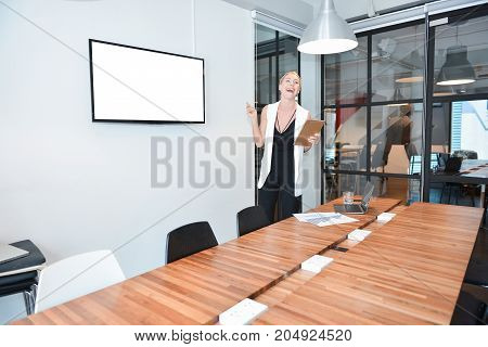 Business Blonde Woman Presenting A Project On Blank Screen Tv
