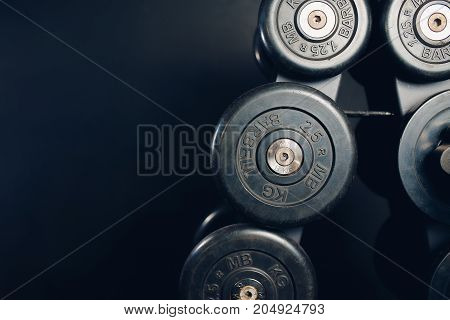 Dumbbells. A series of iron dumbbells in the gym. Copy space