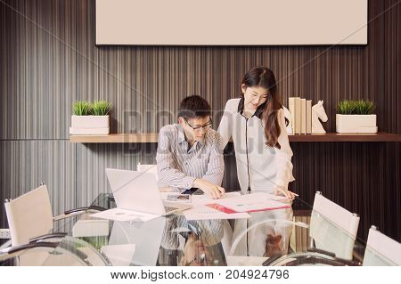Business Coworkers Discussing In Meeting Room In Office