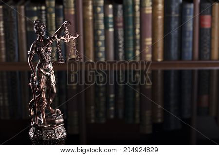 Law theme. Statue of justice in the court library.