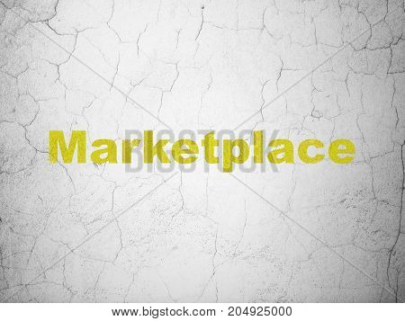 Advertising concept: Yellow Marketplace on textured concrete wall background