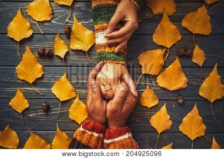 Family Support. Autumn Couple Embrace Shands Top View,fall Ash  Leaf,autumnal Mood,  Relationship