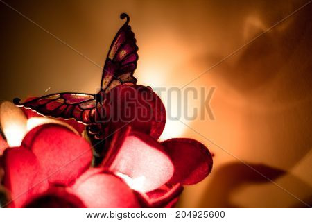 Lamp shaped like a butterfly emits a warm and reassuring light.