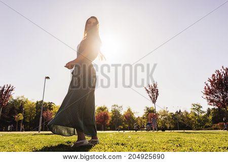 Woman joyful and happy  dancing in park