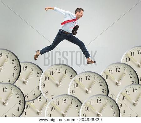 Businessman running over alarm clock. Collage about tardiness and lack of time. concept of business acceleration