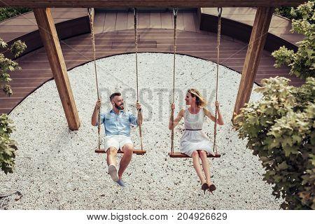 Romantic Couple On Swing