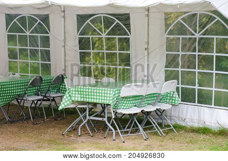 Small group of chairs under white Marquee