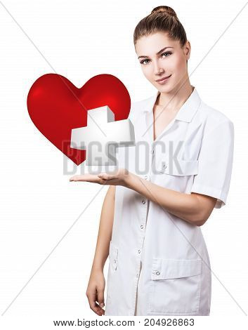 Cardiologist woman doctor holding big red heart and white cross. Healthcare concept.